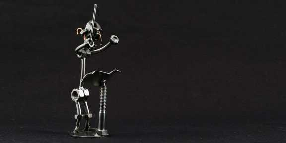 Metal figure of a composer.